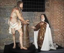 Cristo llagado junto a la Santa