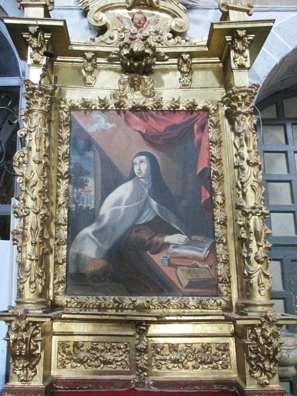Santa Teresa escribiendo inspirada por el Espíritu Santo en Carmelitas Descalzas, Sepulcro de Santa Teresa